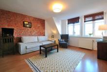 Wohnung Nr. 4 - Wohnzimmer, Sofa, Couchtisch
